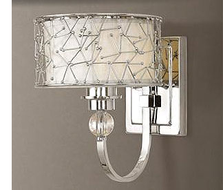 Use sconces on both sides of a bathroom mirror instead of overhead lights.