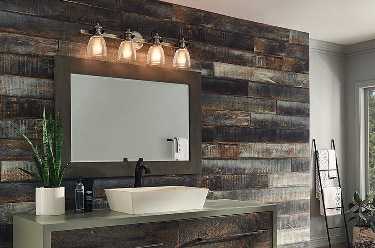 Use multi-light fixtures over wider vanities