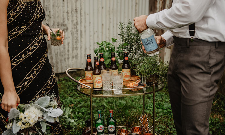 A portable bar cart makes it easy to serve guests a variety of beverages.